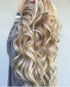 Very nice use of color on gorgeous loose curls.