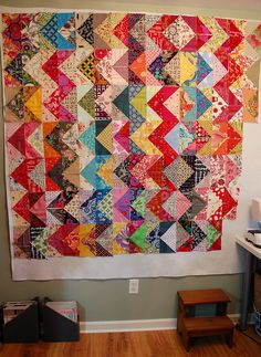 200 half-square triangles on a dreary Saturday morning. I wish it would stop raining! I think I'm going to have to sew this quilt in sections. I want it to be big enough for our bed.