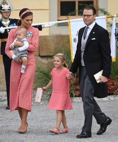Carl Philip's older sister and the future queen of Sweden, Crown Princess Victoria, wearing an Elie Saab cotton-blend lace dress, which cost an eye-watering £3,736, arrived with her family