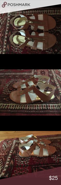 Michael Kors Berkeley T-Strap Flat Sandals 6 Super cute Michael Kors sandals- only selling because they are a size too small for me! 🙁 they are a gorgeous brown with gold tone hardware. Michael Kors Shoes Sandals