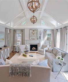 Transitional design, modern furnishings, wood furnishings, light interior, neutral palette, upholstered seating, pendant lighting