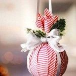 Plastic balls for kids wrapped in fabric with a cheap garland... Cute Christmas gifts/ornaments