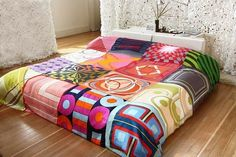 What's great about this bohemian-looking bed spread is that it's DIY, made from vintage silk scarves. #home #DIY #bedroom #decor #tribal #boho #eclectic. I'm in love with this