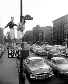 hollyhocksandtulips:  Models Carmen Dell'Orefice and Betsy Pickering, First Avenue and 23rd Street, Harper's Bazaar, 1958.  Photo by William Helburn.