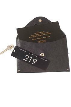hayden-harnett fw 2009 invitation - via t magazine - leather envelope - hotel key trinket