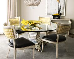 Love the contemporary twist of the bright yellow houndstooth print with the traditional styled chairs.