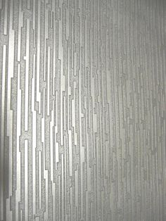 Textured wallpaper again this time more silvery than gold Tge