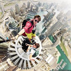 Alexander Remnev and friend on top of the Princess Tower, Dubai. Princess Tower is the world's tallest residential building at 1,358 ft (414 m)