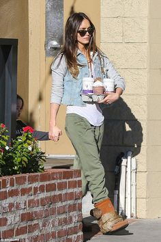 Megan Fox wearing Manitobah Mukluks Tall Mukluk Boots in Copper, Jet Denim Hoodie and Happiness Brand Mility Green Jogger