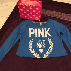 Victory Secret Pink Blue sweatshirt size-L This is a Victoria's Secret pink blue sweatshirt in a size large. The bottom of the shirt is cut. This is a use shirt, but it still has a lot of life left. I am cleaning out my closet and it is time for this shirt to have a new home. Please feel free to ask any questions. PINK Victoria's Secret Tops Sweatshirts & Hoodies