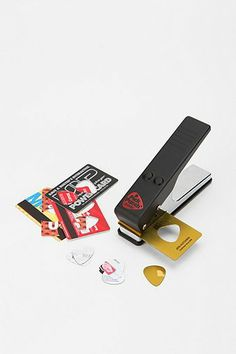 Guitar Pick Hole Punch - Punches a guitar pick shaped hole in business and gift cards!