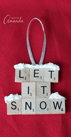 """Make a """"Let It Snow"""" scrabble tile ornament from scrabble tiles and snow texture paint! So easy to make, you will need a paper plate and some felt too, great to give as gifts! A fun Christmas ornament project for kids and adults. Christmas Crafts For Adults, Christmas Ornaments To Make, Xmas Crafts, Homemade Christmas, Diy Christmas Gifts, Christmas Fun, Scrabble Christmas Decorations, Scrabble Ornaments Diy, Christmas Island"""