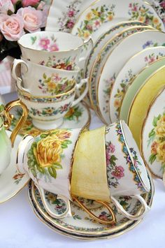 Examples of tea cups and saucers. Floral,gold. English Victorian style. Mad hatter tea party. Alice in wonderland.