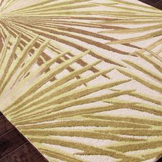 Hand-tufted wool rug with palm frond motif.   Product: RugConstruction Material: 100% WoolColor: Cloud...