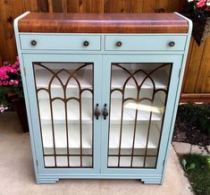"""Brandy Miller of Blue Daisy Furniture delighted us with this charming cabinet in blue! She elaborates, """"I used Antique Walnut Gel Stain for the top and Persian Blue Milk Paint for the body. The whole piece was finished with HP Topcoat Satin. I absolutely LOVE your products! They are so easy to use and make refinishing furniture fun!"""""""