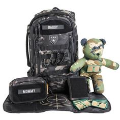 Daypack Full Load Out Set Includes: Daypack Built-In 'Drop Zone' Changing Mat Dump Pouch Tactical Teddy™ Number Patch Set Wipe Pouch Daddy & Mommy Patch TBG Carabiner Set Camo Backpack, Diaper Bag Backpack, Dad Diaper Bag, Molle Accessories, Beach Toys, Changing Mat, Baby Gear, Baby Shower Gifts, Baby Boy