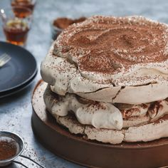Tiramisu Pavlova - We've given our pavlova a coffee twist! This double layered tiramisu pavlova might just be our most indulgent dessert. Meringue Desserts, Just Desserts, Chocolate Meringue, Chocolate Pavlova, Baking Recipes, Cake Recipes, Dessert Recipes, No Bake Cake, Sweet Recipes