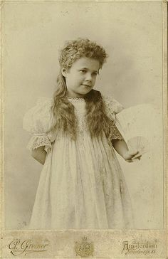 Antique Photo Album: Girl with a fan, via Flickr.