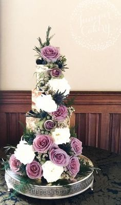 Breathtakingly unique purple and white flower accented wedding cake; Featured Cake: Juniper Cakery
