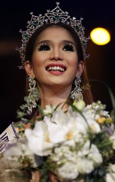 Kevin Balot, a contestant from the Philippines, reacts as being crowned winner at the Miss International Queen 2012 transgender/transsexual beauty pageant in Pattaya November 2, 2012. Some 21 contestants from 15 countries, all of them born male, competed in a week-long event for the crown of Miss International Queen 2012. (Photo by Damir Sagolj/Reuters) http://avaxnews.net/wow/An_Amazing_Street_Art.html #avaxnews.net #fashion #girl