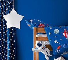 Novelty lighting like this space themed ceiling lamp from John Lewis, will brighten up your children's room