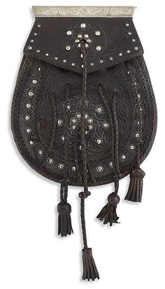 A late 18th century Scottish hand tooled leather sporran {pouch] w/ studded details