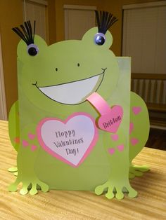 Britton's 2nd grade Frog Valentine Bag. Very simple to make, card stock, google eyes and glue.  I cut it out and she glued it together.