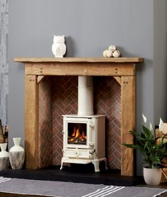 Barkston: Extremely Aged Oak in a Light/Medium Finish Small Herringbone Hand Painted Vermiculite Panel: Brick Finish Focus Fireplaces, Fireplace Lighting, Fireplace Surrounds, Wood Burner Fireplace, Fireplace Mantels, Fireplace Ideas, Wood Stove Surround, Stove Paint, Fireplace Gallery