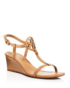 007f76d6f1e Switch things up from your usual flip flop with Tory Burch s T-strap wedge  sandals