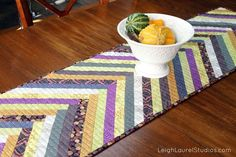 No need to buy a fancy table runner when you can DIY one. These table runner tutorials and patterns include those for any occasion and season, fall to Patchwork Table Runner, Table Runner And Placemats, Quilted Table Runners, Table Runner Tutorial, Table Runner Pattern, Quilted Placemat Patterns, Herringbone Quilt, Chevron Table, Quilting Tutorials
