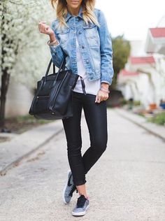 blonde woman with black pants, tennis shoes, and a jean jacket