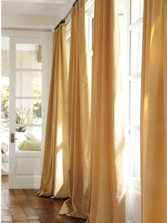 These modern curtains make such a good color to brighten a room!