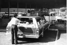 Car Hop Delivers Food To Rear Of Car At Tiny Naylor's Drive In Restaurant in Hollywood