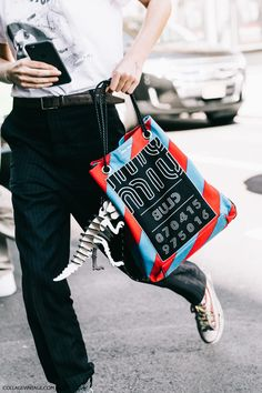 Miu miu bag with dinosaur keychain