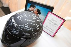 Our wedding guestbook - a motorcycle helmet. It's now the centerpiece of our living room and we see it everyday!