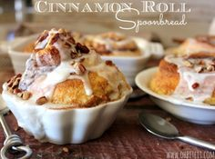 Cinnamon Roll Spoonbread!  These moist and tender Cinnamon Rolls are covered in a rich cream & nestled deep into a thick, smooth and dreamy Vanilla Custard.  Gently topped with a sprinkling of crunchy Pecans! No sticky fingers and sleeves allowed here, this is spoon and napkin territory!