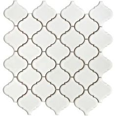 "Merola ""lantern"" ceramic tile. Home Depot $6.95 sq ft. It's a knockoff of Beveled Arabesque"" that is $22.95 per square foot at Mission Stone & Tile"