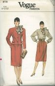 An unused original ca. 1980's Vogue pattern 8770.  Semi-fitted, lined, above hip jacket has extended shoulders, shoulder pads, front seams, welt pocket and two-piece, long sleeves. Straight skirt, below mid-knee, has waistband, pockets and concealed, buttoned closing. Loose-fitting, pullover blouse has collar, attached single layer tie ends, dropped shoulders, buttoned shoulder closing and long sleeves with buttoned cuffs. Purchased belt.