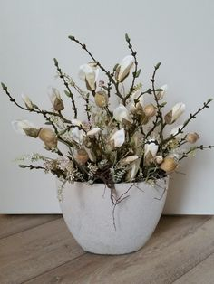 Flower arrangement of artificial Magnolias and Poppies