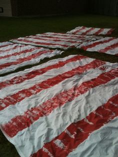 Painted sheets... buy up white sheets from thrift stores for this project. Great for the game midway.