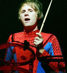 Dominic Howard - I love British people. And yes, yes he is wearing a spider-man outfit. - Why I love Muse. :)
