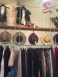 DIY closet racks. Hang your clothes from the ceilings with rope, chain, and some simple rods. Smart idea.