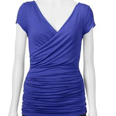 """Candie's Shirred Top Asymetric shirred top in royal blue. 95% rayon 5% spandex. Product Description: Make your presence known in this delightful juniors' asymmetric shirred top from Candie's. Wrap front, ruched sides. Color most represents first picture as it was hard to capture. Aprox measurements laying flat Bust 15"""" Length 24 1/2""""  ✅Offers Welcomed Trade Candie's Tops Blouses"""