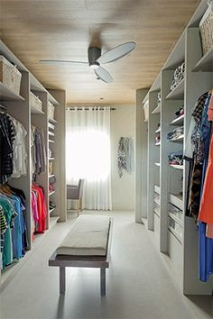The guest room has been turned into a spacious walk-in closet %u2014 the type of space that many women (and men!) dream of having. The open shelves and cabinets allow the homeowner to instantly see all of her clothes, accessories, and other belongings.�