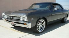 This 1967 Chevrolet Chevelle SS 454 Pro Touring has recently been subjected to a full body restoration. As you can see, the Gun Metal Gray paint job with the arrow body panels is top notch! The car has been lowered for 2 inches and it looks amazing with its 20×10 polished wheels and the Budnik Gasser 18 x8, perfectly inserted under the muscle monster. Grey