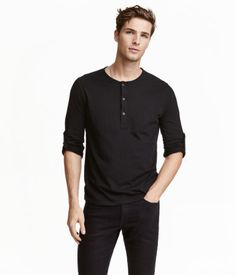 20812a001d Black. Henley shirt in jersey with a button placket and long sleeves with  roll-