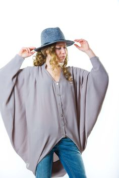 A personal favorite from my Etsy shop https://www.etsy.com/listing/267258027/batwing-silk-button-up-blouse-womens