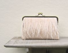 Ostrich feather clutch, nude bridal clutch, peach wedding purse, peach wedding, nude bridesmaid clutch, clutch with chain, constance clutch by ConstanceHandcrafted on Etsy https://www.etsy.com/uk/listing/206360870/ostrich-feather-clutch-nude-bridal