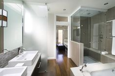 Can laminate wood floor be used in a bathroom. What type of product is recommended?