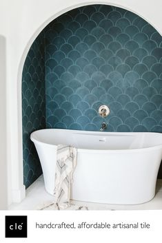 easily one of our most emerging popular cement tile shapes, the scallop is quickly coming into its own. this shape offers a soothingly soft repetition with a form that gives a nod to the nautical: think seashells, or even better–mermaids. shown here, our cement tile on the wall of this bathtub. #cement #tiles #bathroom #shower #design